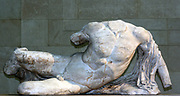 Greek Statue of a naked youth reclining. From the Parthenon, Athens.