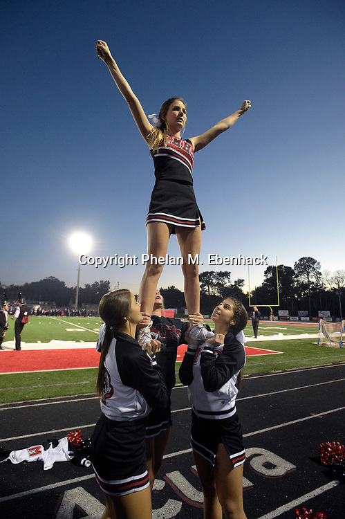 The Lake Mary cheerleaders perform before a high school football game against Orange City University in Lake Mary, Fla., Friday, Oct. 31, 2014. (Photo by Phelan M. Ebenhack)