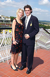 LADY ALEXANDRA GORDON-LENNOX and MR JULIAN DRAPER at the 4th day of the annual Glorious Goodwood horseracing festival held at Goodwood Racecourse, West Sussex on 30th July 2004.