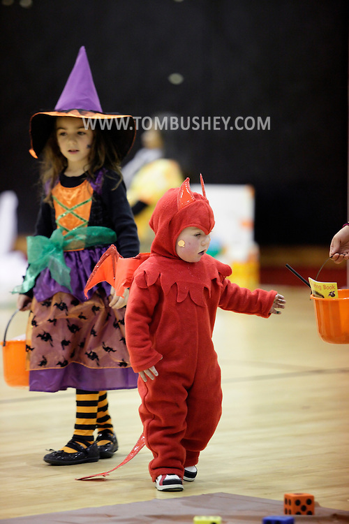 Middletown, New York  - Children in costumes play games in the gymnasium during the Middletown YMCA Family Fall Festival on Oct. 29, 2011.
