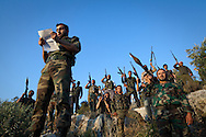 Soldiers from the Free Syrian Army (FSA) prepare to make a public defection video, stating that they have formed a new battalion with the FSA after defecting from the Regime's military. Idlib province in Syria's northwest is one of the few areas in Syria which is currently under FSA control, although this control is patchy and ever shifting. Rural Idlib, Syria. 19/06/2012