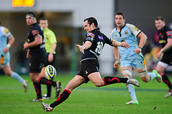 Dragons Fly-Half (#10) Dan Evans kicks during the first half of the match - Photo mandatory by-line: Rogan Thomson/JMP - Tel: Mobile: 07966 386802 18/11/2012 - SPORT - RUGBY - Rodney Parade - Newport. Newport Gwent Dragons v Northampton Saints - LV= Cup Round 2