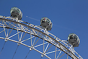 Close-up views of some of The London Eye's pods, seen from the north side of the River Thames. A BA plane passed overhead as a pod with a man in red passed by