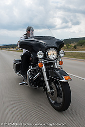 David Campbell on his 2009 Electraglide Classic on the Aidan's Ride to raise money for the Aiden Jack Seeger nonprofit foundation to help raise awareness and find a cure for ALD (Adrenoleukodystrophy) during the annual Sturgis Black Hills Motorcycle Rally. I-90 between Rapid City and Sturgis, SD, USA. Tuesday August 8, 2017. Photography ©2017 Michael Lichter.