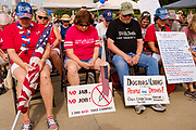 24 JULY 2021 - DES MOINES, IOWA: People pray during the World Wide Freedom Rally in Des Moines. More than 200 people showed up at the Iowa State Capitol Saturday for the World Wide Freedom Rally. The protesters called for governments everywhere to respect five important freedoms: Freedom of Speech, Movement, Choice, Assembly, and Health. Their main concern Saturday was Freedom of Health, which they said included the freedom to refuse vaccinations and the freedom to refuse to wear face masks, even during the time of airborne viruses.       PHOTO BY JACK KURTZ