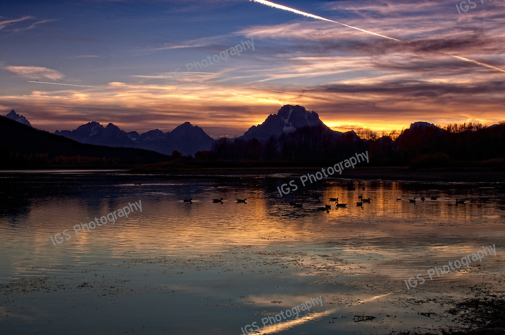 Jet Contrail relected in OxBow bend on the Snake RIver