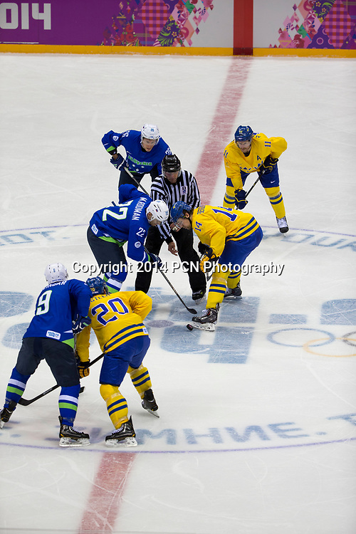 Marcel Rodman (SLO)-22, Patrik Berglund (SWE)-14 faceoff during Sweden vs Slovenia game at the Olympic Winter Games, Sochi 2014