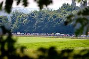 Nederland, Groesbeek, 21-7-2016Deelnemers aan de 100e, honderdste 4daagse, vierdaagse, lopen op de derde dag, de dag van Groesbeek, o.a over de zevenheuvelenweg.  Het is de zwaarste dag vanwege de heuvels. Ook brengen veel militairen, en zeker die uit Canada, een bezoek aan de Canadese militaire begraafplaats waar honderden gesneuvelde soldaten liggen die hier in 1944 gevochten hebben.4 Daagse, Dag van Groesbeek, Zevenheuvelenweg.  De vierdaagse is het grootste wandelevenement ter wereld. Deze dag is beroemd vanwege de heuvels die belopen moeten worden. Blaren en voeten worden verzorgd op een hulppost van Rode Kruis en de landmacht. Ook de plaatselijke bevolking en vooral de jeugd verzorgen veel afleiding met muziek, water en eten en drinken op het parcours .The International Four Day Marches Nijmegen, or Vierdaagse, is the largest marching event in the world. It is organized every year in Nijmegen mid-July as a means of promoting sport and exercise. Participants walk 30, 40 or 50 kilometers daily, and on completion, receive a royally approved medal , Vierdaagsekruis. The participants are mostly civilians, but there are also a few thousand military participants. Today was the day of GroesbeekFoto: Flip Franssen