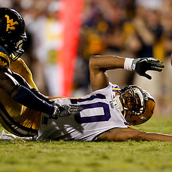 Sep 25, 2010; Baton Rouge, LA, USA; West Virginia Mountaineers cornerback Brandon Hogan (22) is called for pass inference against LSU Tigers wide receiver Russell Shepard (10) during the second half at Tiger Stadium. LSU defeated West Virginia 20-14.  Mandatory Credit: Derick E. Hingle