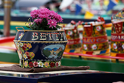 © Licensed to London News Pictures. 06/05/2013, London, UK.  A flower pot is seen on top of a canal boat during the Canalway Cavalcade waterway festival at Little Venice in London, Monday, May 6, 2013. Photo credit : Sang Tan/LNP