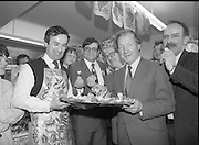 Taoiseach's Election Campaign.      (N77)..1981..23.05.1981..05.23.1981..23rd May 1981..On the 21st May the Taoiseach, Mr Charles Haughey, dissolved the Dáil and called a general election. Charles Haughey, Garret Fitzgerald and Frank Cluskey were leading their respective parties into a general election for the first time as they had only taken party leadership during the last Dáil..Fianna Fáil had hoped to call the election earlier, but the Stardust Tragedy caused the decision to be deferred...Tom Wright (left) is pictured offering Charles Haughey a sample of Dublin Bay Prawns and salmon on his walkabout in Malahide.