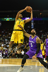 July 6, 2018 - Oakland, California, United States - Ball Hogs Josh Childress (7) goes up for a shot as Ghost Ballers Carlos Boozer (5) defends during Week 3 of the BIG3 3-on-3 basketball league at Oracle Arena. (Credit Image: © Debby Wong via ZUMA Wire)