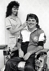 Carer with disabled man, UK 1990s