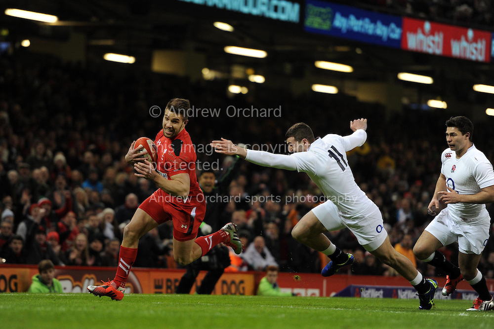 Rhys Webb of Wales goes past England's Jonny May and runs in to score the 1st try.RBS Six nations championship 2015, Wales v England at the Millennium Stadium in Cardiff, South Wales on Friday 6th  Feb 2015. pic by Andrew Orchard, Andrew Orchard sports photography.