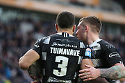 Hull FC outside back Carlos Tuimavave (3) scores his second try to make the score 12-24 and celebrates with his team mates during the Betfred Super League match between Hull FC and St Helens RFC at Kingston Communications Stadium, Hull, United Kingdom on 16 February 2020.