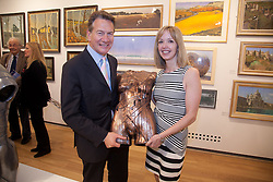 © London News Pictures. 28/02/2012.. Rt. Hon. Michael Portillo MP and Louise Giblin hold one of the body casts from her Olympian Series. Rt. Hon. Michael Portillo MP opens the the private view of the 295th Exhibition of The Royal Society of British Artists at the Mall Galleries, London, UK. Picture credit should read Manu Palomeque/LNP