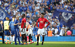 Manchester United's Chris Smalling (right) stands dejected after the game
