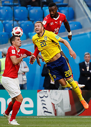 July 3, 2018 - Saint Petersburg, Russia - Ola Toivonen (C) of Sweden national team vies for a header with Granit Xhaka (L) and Johan Djourou of Switzerland national team during the 2018 FIFA World Cup Russia Round of 16 match between Sweden and Switzerland on July 3, 2018 at Saint Petersburg Stadium in Saint Petersburg, Russia. (Credit Image: © Mike Kireev/NurPhoto via ZUMA Press)