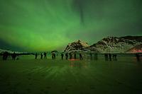 Crowds of northern lights photographers on Vik beach, Vestvågøy, Lofoten Islands, Norway