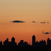 The Manhattan skyline fringes shot from the Arthur Ashe Tennis Stadium, Queens New York, USA. 4th September 2013. Photo Tim Clayton