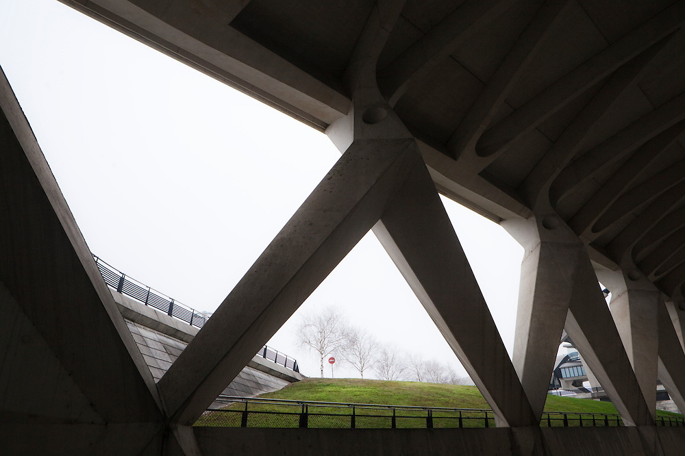 A row of trees outside the concrete interior of the Saint-Exupéry airport railway station in Lyon, France.