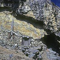 NEPAL, HIMALAYA. Remote Tibetan Buddhist shrine where Padmasambhava is thought to have meditated in remote Hinku Valley, Nepal.