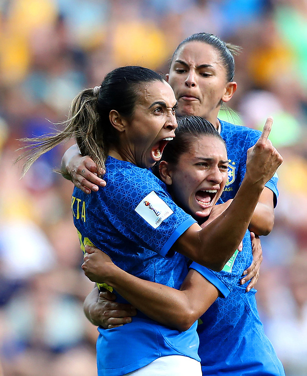 MONTPELLIER, FRANCE - JUNE 13: Marta of Brazil celebrates with teammates after scoring her team's first goal during the 2019 FIFA Women's World Cup France group C match between Australia and Brazil at Stade de la Mosson on June 13, 2019 in Montpellier, France. (Photo by Elsa/Getty Images)