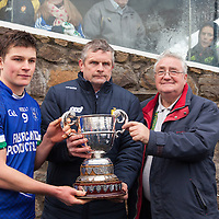 Cratloe's Captain Liam Markham and Chairman of Cratloe GAA club receives the winning Clare Cup from Cllr. Joe Cooney, Clare GAA Vice Chairman