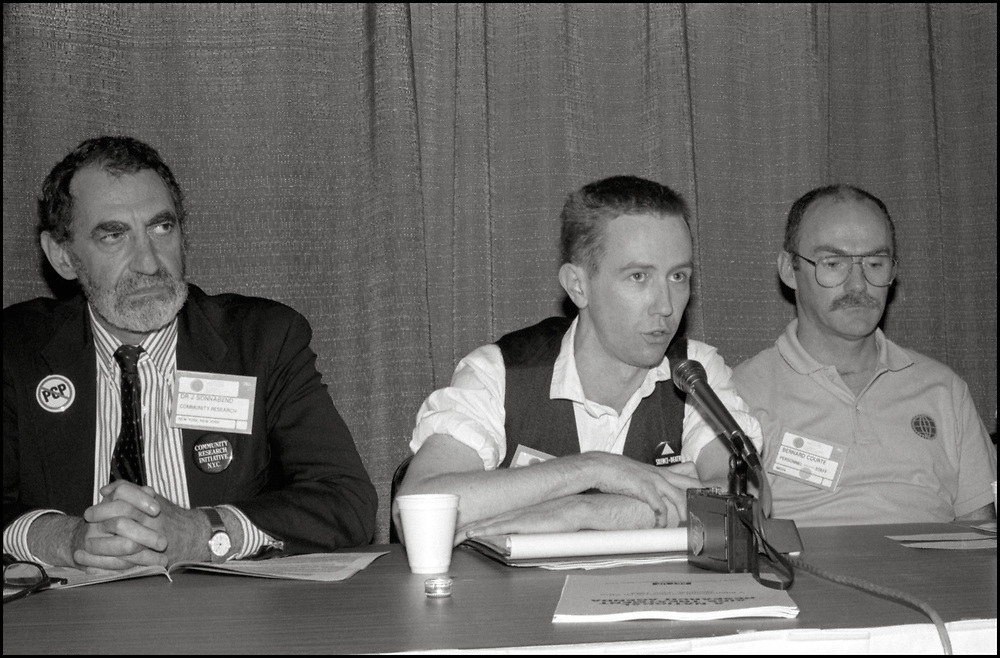 Joseph Sonnabend, an Afrikaans physician, and Mark Harrington of ACT UP speaking on a panel about the possible Antiviral drugs that could be used to combat HIV/AIDS at the Fifth International AIDS Conference in Montreal.