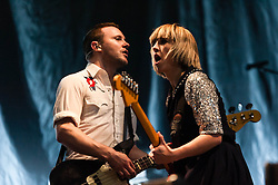 © Licensed to London News Pictures. 22/02/2013. London, UK.   Rhydian Dafydd (left) and Ritzy Bryan (right) of The Joy Formidable performing live at Earls Court, supporting headliner Bloc Party.   The Joy Formidable is a Welsh alternative rock band formed in 2007 in North Wales and currently located in London, England. The band consists of Ritzy Bryan (lead vocals, guitar), Rhydian Dafydd (bass, backing vocals), and Matt Thomas (drums, percussion).Photo credit : Richard Isaac/LNP