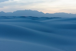 Sunset on sand dunes  and vegetation at White Sands National Monument, New Mexico, USA.