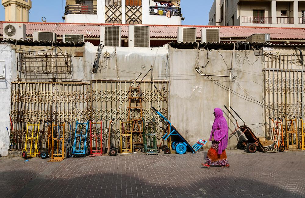 UNITED ARAB EMIRATES, DUBAI - CIRCA JANUARY 2017: Woman walks in Deira, on some of the back streets of the Gold Souq in Dubai