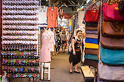 16 FEBRUARY 2013 - BANGKOK, THAILAND:   Shoppers walk through Chatuchak Weekend Market in Bangkok. It is reportedly the largest market in Thailand and the world's largest weekend market. Frequently called J.J., it covers more than 35 acres and contains upwards of 5,000 stalls.         PHOTO BY JACK KURTZ