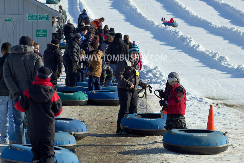 Hamptonburgh, New York - People wait in line to ride up the tow line on the snow tubing hill at Thomas Bull Memorial Park on Jan. 6, 2013.