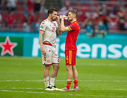 AMSTERDAM, THE NETHERLANDS - Saturday, June 26, 2021: Wales' Ben Davies (R) and Denmark's Pierre-Emile Højbjerg after the UEFA Euro 2020 Round of 16 match between Wales and Denmark at the Amsterdam Arena. Denmark won 4-0. (Photo by David Rawcliffe/Propaganda)