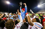 AC Flora Falcons head coach Dustin Curtis is lifted up by his players following their State Championship win over the North Myrtle Beach Chiefs at Benedict College.