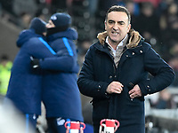 Football - 2017 / 2018 Premier League - Swansea City vs. Tottenham Hotspur<br /> <br /> Swansea City manager Tomas Carvalhal looks frustrated on the touchline as Spurs manager Mauricio Pochettino celebrates his team's 2nd goal in background, at The Liberty Stadium.<br /> <br /> COLORSPORT/WINSTON BYNORTH