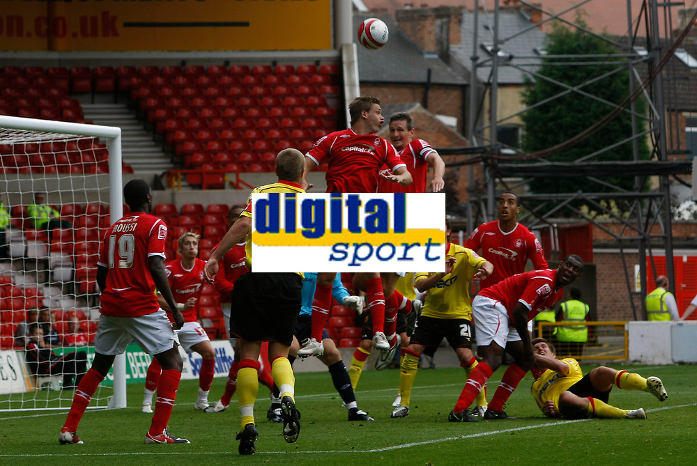 Photo: Steve Bond/Richard Lane Photography.<br />Nottingham Forest v Watford. Coca-Cola Football League Championship. 23/08/2008. Luke Chambers (C) clears as Forest defends