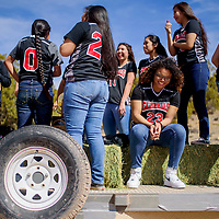 Delila Nakaidine, right, and the rest of the district 1A girls state champion team ride on float during a parade to honor their victory at Saint Michael High School in Saint Michaels Friday.
