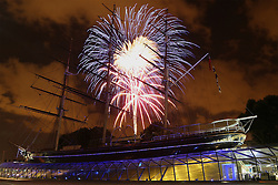 © Licensed to London News Pictures. 29/08/2013. The famous tea clipper, the Cutty Sark, lit up by fireworks in Greenwich. The fireworks were launched on the river as part of the Sail Royal Greenwich tall ships event. credit : Rob Powell/LNP