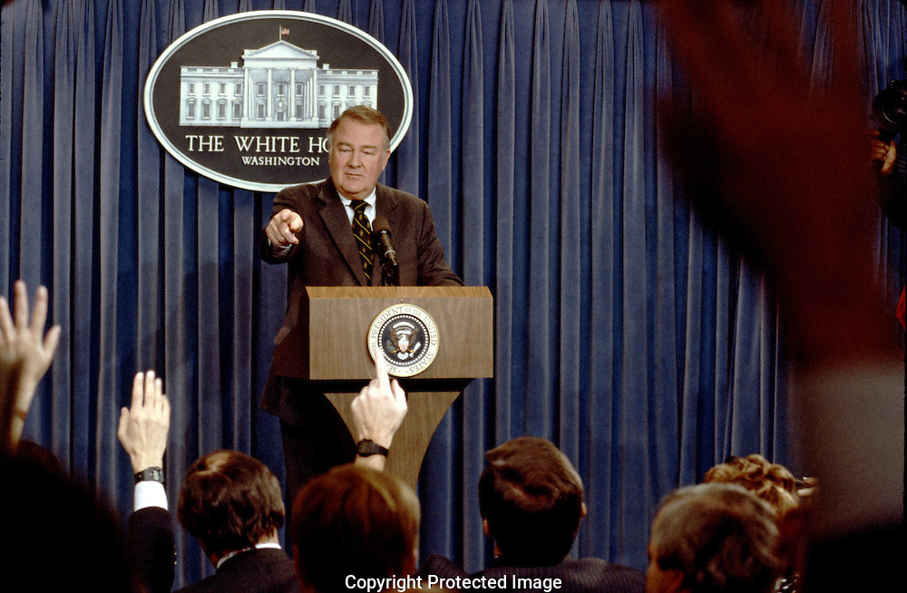 Attorney General Ed Meese points to a reporter at a press conference in the press briefing room in December 1986..Photo by Dennis Brack BSB 18