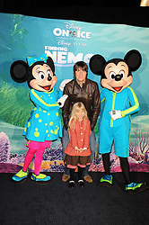 """DAN HIPGRAVE, his daughter HONEY (his daughter with Gail Porter) photographed with Micky Mouse &  Minnie Mouse at a VIP Opening night of Disney & Pixar's """"Finding Nemo on Ice"""" at The O2 Arena Grennwich London on 23rd October 2008."""