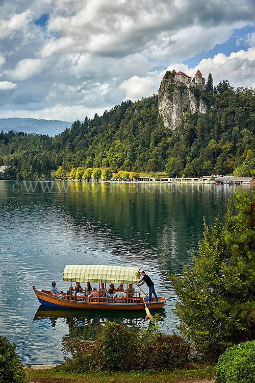 A pletna boat glides on Lake Bled in the town of Bled, Slovenia.