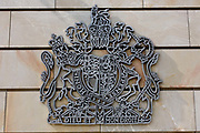 Royal Coat of Arms of the United Kingdom of Great Britain and Northern Ireland, the official coat of arms of the British monarch, on the exterior wall of the British Embassy, the United Kingdom's diplomatic mission to Germany in Berlin. It is located on 70-71 Wilhelmstraße, near the Hotel Adlon. Upon reunification in 1991, an architectural competition was won by Michael Wilford and the new building opened by Queen Elizabeth II on 18 July 2000.