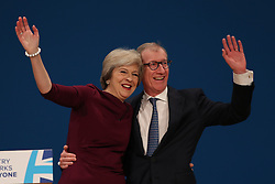 October 5, 2016 - Birmingham, United Kingdom - Image licensed to i-Images Picture Agency. 05/10/2016. Birmingham, United Kingdom. Prime Minister Theresa May and her husband Philip at the end of her keynote speech on the final day of the Conservative Party Conference  in Birmingham, United Kingdom.  Picture by Stephen Lock / i-Images (Credit Image: © Stephen Lock/i-Images via ZUMA Wire)