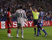 Photo: Paul Thomas.<br /> Porto v Liverpool. UEFA Champions League Group A. 18/09/2007.<br /> <br /> Jermaine Pennant (L) of Liverpool is sent off by referee Lubos Michel (Yellow) for a second yellow.
