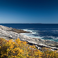 View east along the rocky coastline of Pemaquid Lighthouse Park.  Clear summer day.