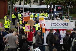 © Licensed to London News Pictures . 22/05/2019. Salford, UK. Dozens of police patrol as former EDL leader Stephen Yaxley-Lennon (aka Tommy Robinson ) holds a campaign rally at the derelict Mocha Parade shopping precinct in Salford and anti-fascists hold a counter protest . Yaxley-Lennon is running for a seat in the European Parliament representing the North West of England . Photo credit: Joel Goodman/LNP