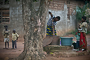 A woman pulls a rope to fetch the water from a traditional well in the suburb of Bangui, Central African Republic.