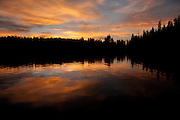 Dawn sky reflecting in Bear Lake at Rocky Mountain National Park, Colorado